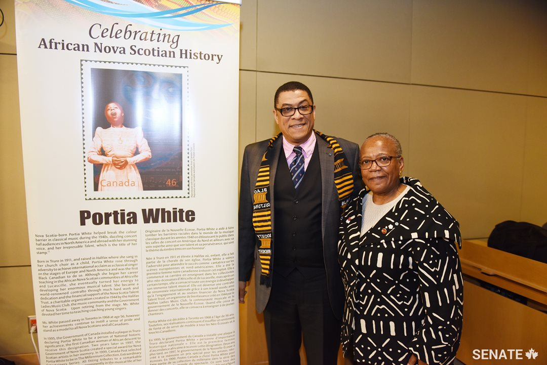 Committee chair Senator Wanda Thomas Bernard, right, chats with Craig Smith, chair and president of the Black Cultural Society for Nova Scotia.