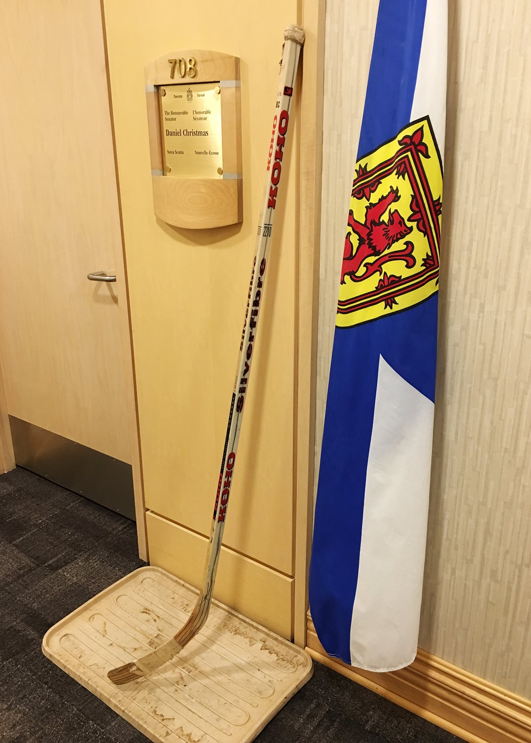 A hockey stick outside Senator Dan Christmas's office.