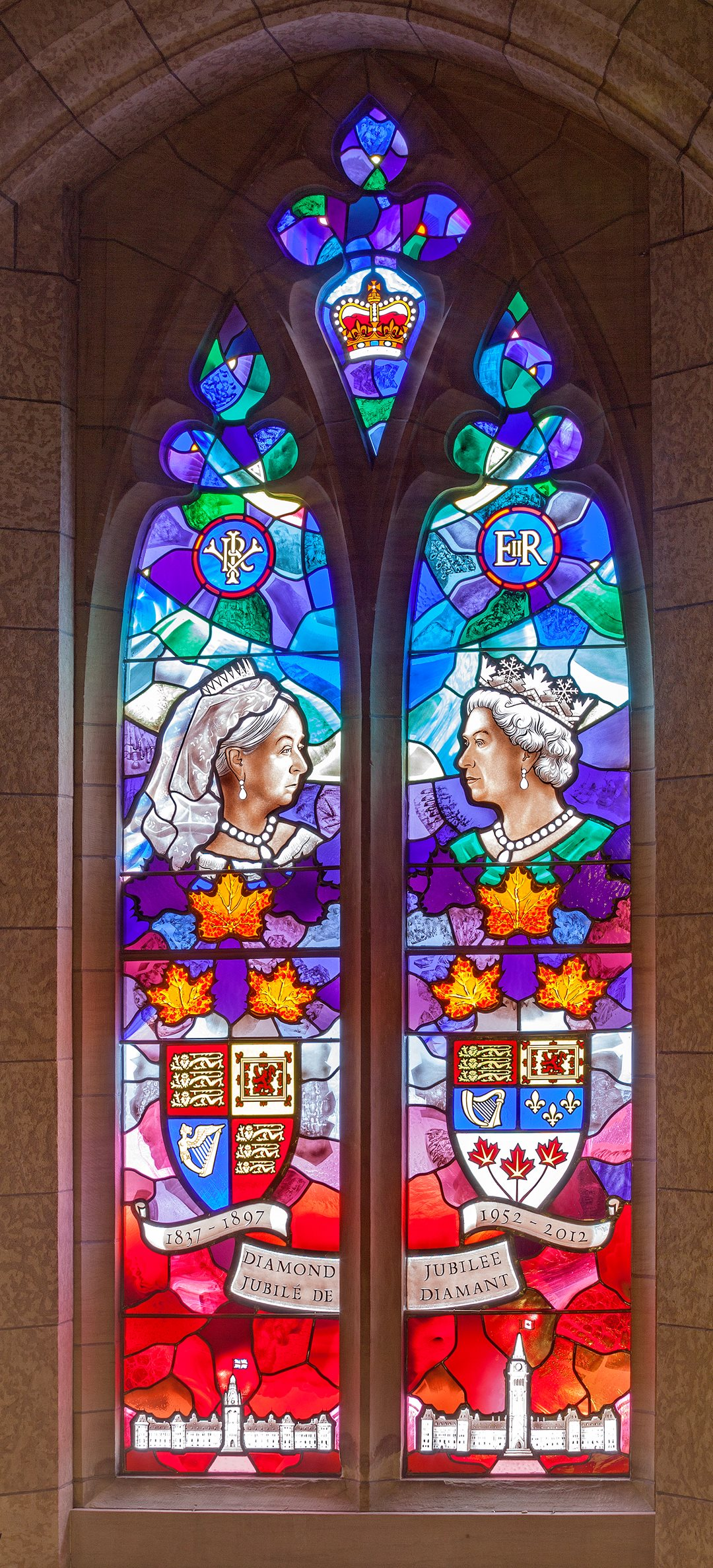 A stained-glass window above the Senate entrance to Centre Block depicts Queen Victoria on the occasion of her Diamond Jubilee in 1897, beside her great-great-granddaughter, Queen Elizabeth II, who marked her own Diamond Jubilee 115 years later in 2012. Below Victoria appears the original Centre Block and its iconic Victoria Tower, 19 years before they were gutted in the 1916 fire.