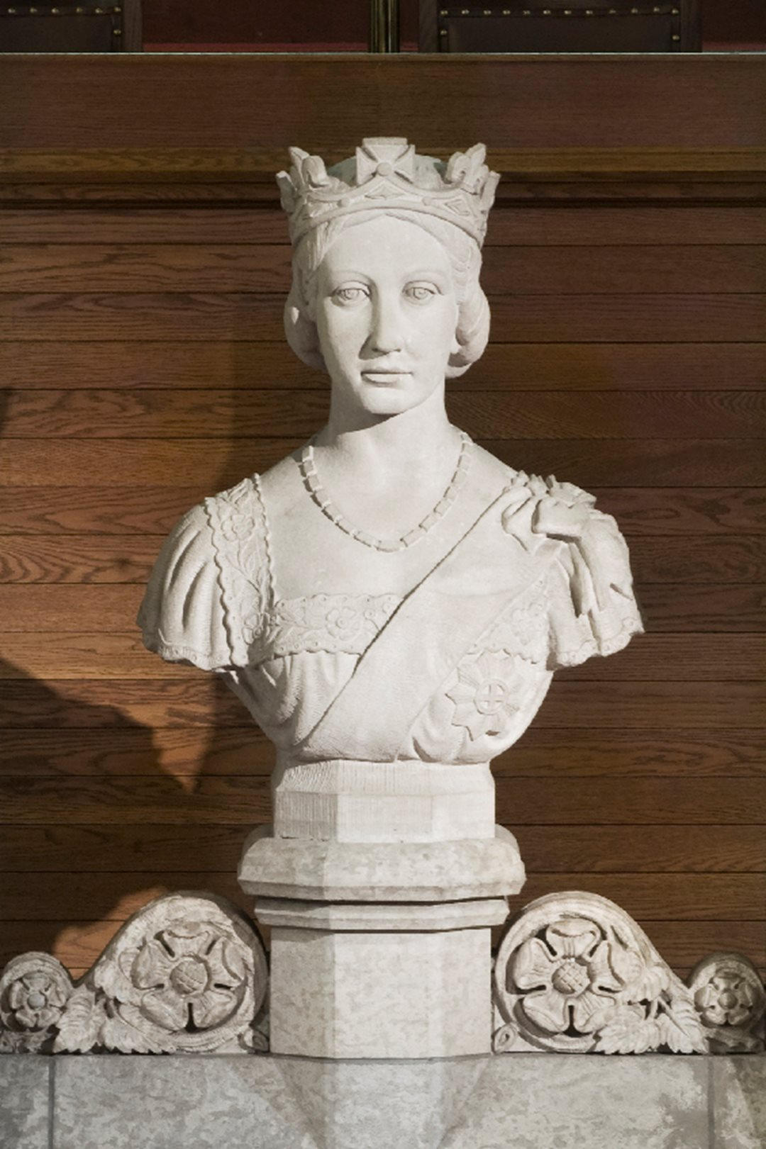 A marble bust of Victoria surveys the Senate from its position above the thrones and Speaker's chair.