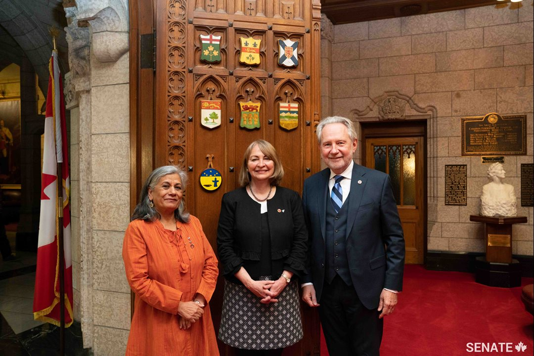 New Senator Donna Dasko, centre, is joined by senators Ratna Omidvar and Peter Harder after her swearing-in ceremony on Thursday, June 7, 2018.