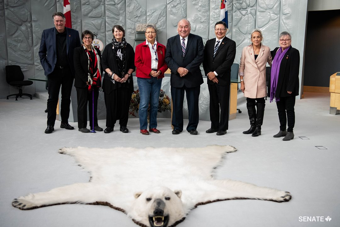 Members of the Senate Committee on Aboriginal Peoples join Northwest Territories Premier Bob McLeod in the chamber of the Legislative Assembly in Yellowknife. The premier expressed his appreciation of the committee's work on their fact-finding mission.