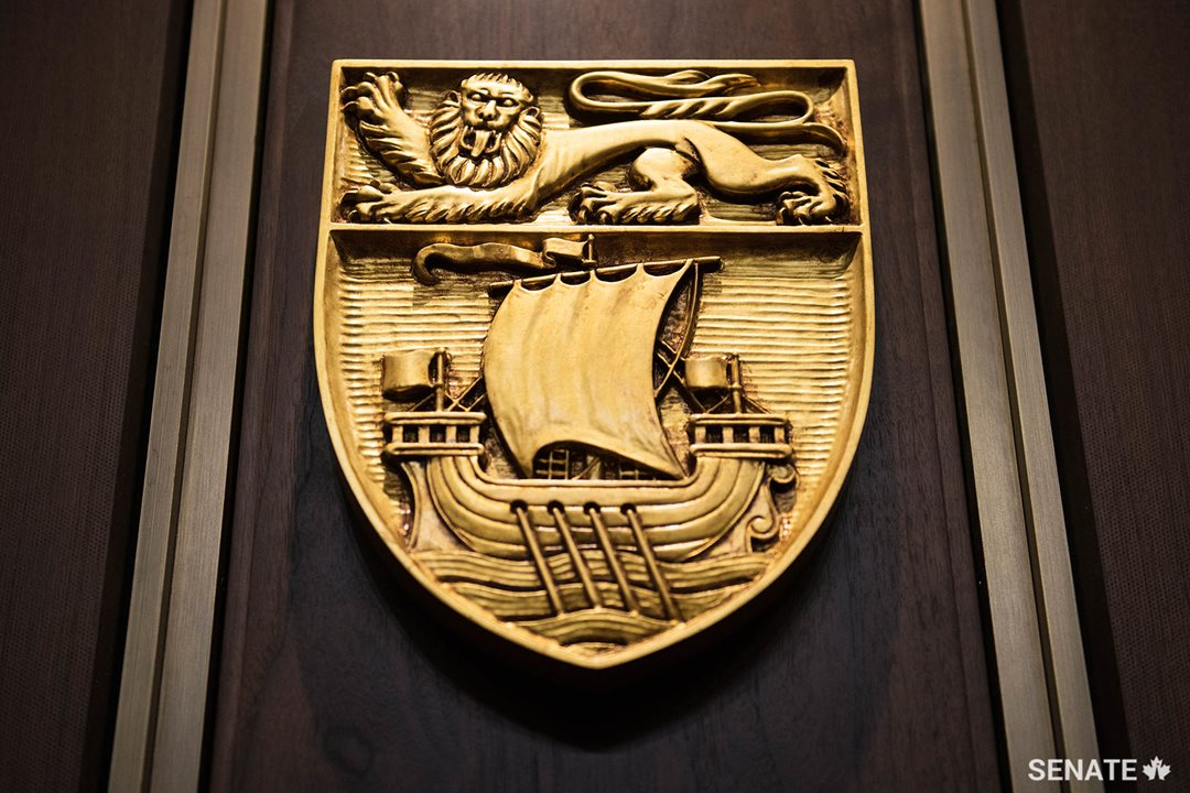 The shield of New Brunswick features an English lion above a galleon that evokes the province's historic connection to the sea.
