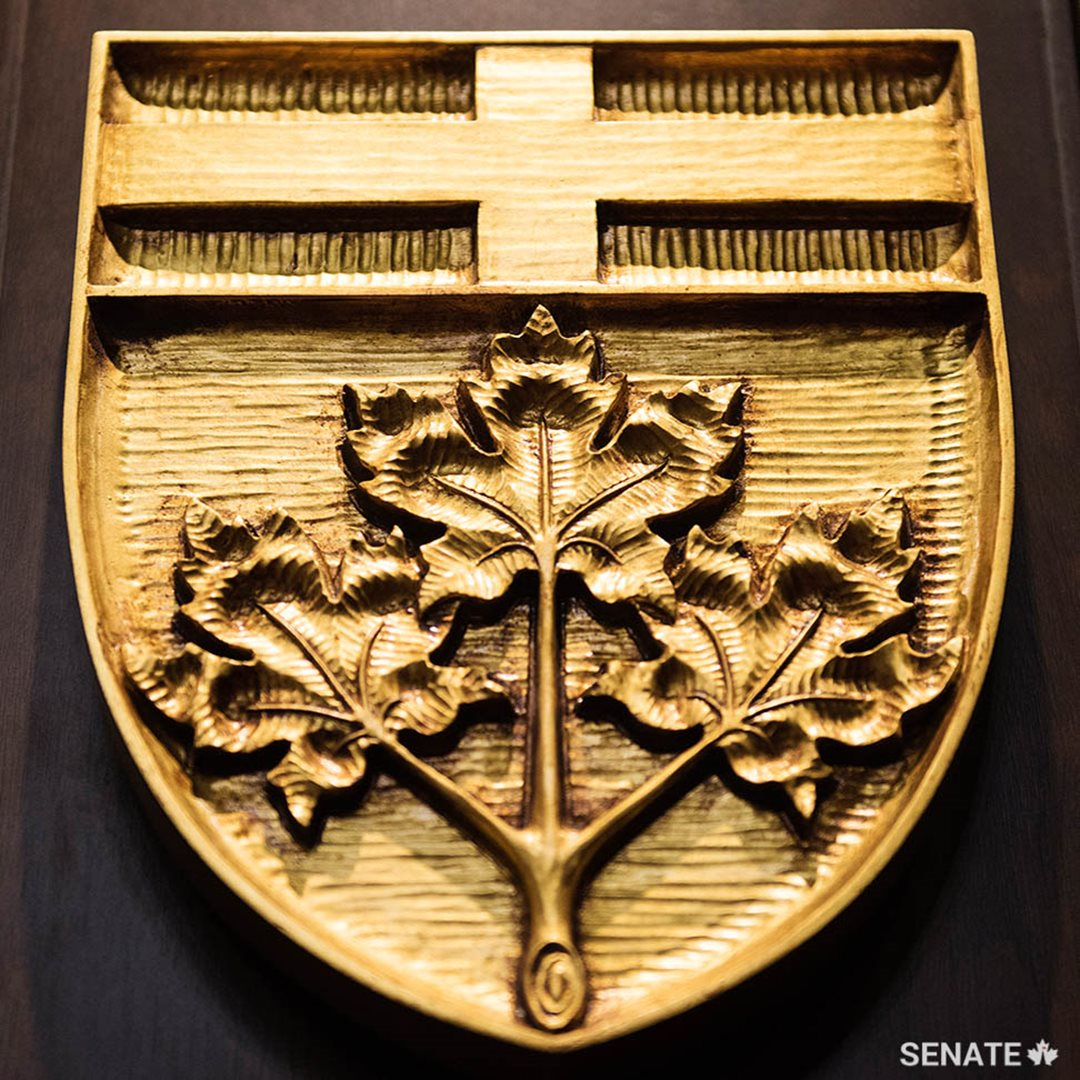 Three maple leaves and the Cross of St. George decorate Ontario's shield.