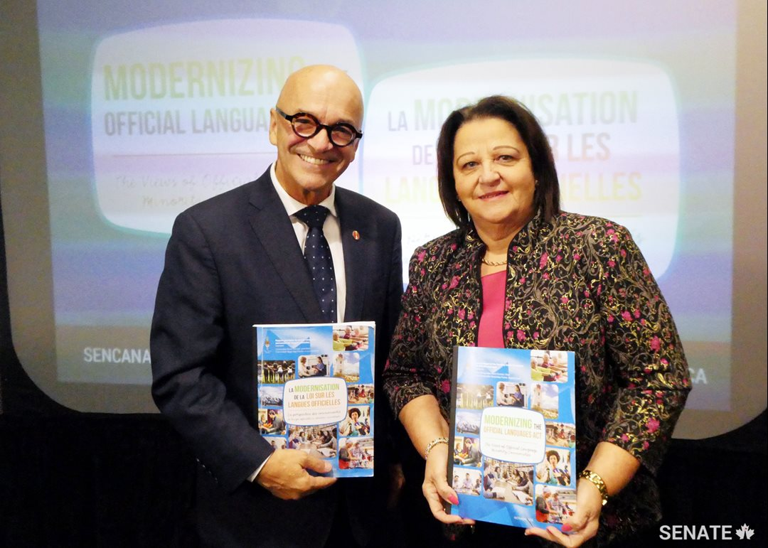 On Thursday, October 25, 2018, in Moncton, Senator René Cormier, Chair, and Senator Rose-May Poirier, Deputy Chair, present the Committee on Official Languages report entitled Modernizing the Official Languages Act: The Views of Official Language Minority Communities.