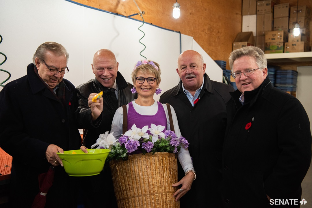On October 31, Halloween, the committee visits the Wise Earth Farm in Kelowna, BC, where they are welcomed with a basket of living flowers. The day began on a sweet note.
