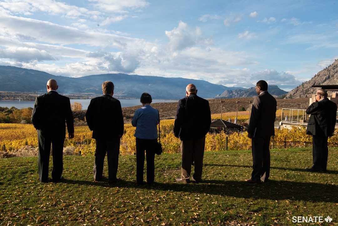 Members of the Agriculture committee admire the view from Nk'Mip Cellars, the first Indigenous-owned winery in North America. Despite winning many national and international awards, they are still unable to sell their products in several of Canada's provinces or in any of the territories.