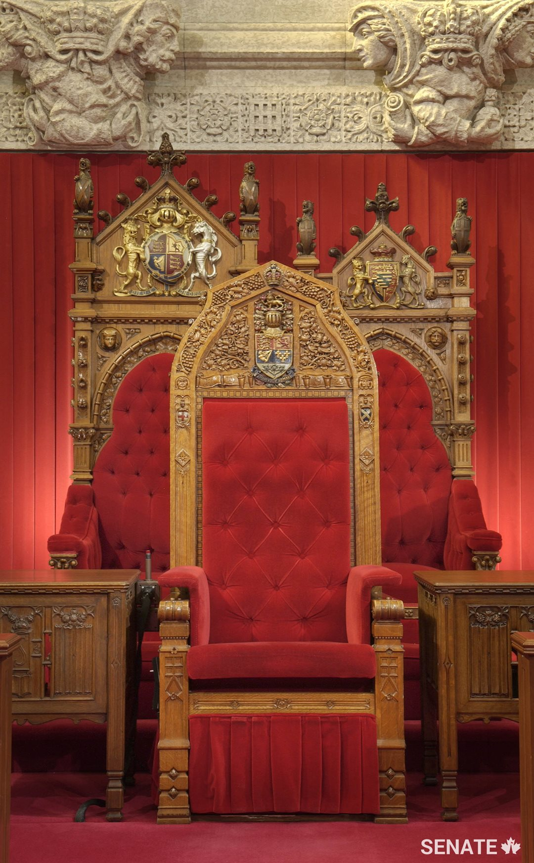 The monarch's and consort's thrones, carved in 1878, are among the very few Senate fixtures salvaged from the 1916 fire that destroyed the original Centre Block. The Senate Speaker's chair in front was carved in 1923. All three went into storage and less ornate versions created specifically for the new Senate Chamber are being used in the interim.
