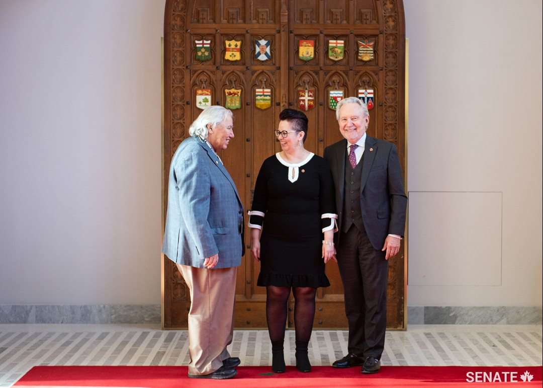 Senator Murray Sinclair, left, and Senator Peter Harder welcome Senator Margaret Dawn Anderson to the Senate after her swearing-in ceremony on February 19, 2019.