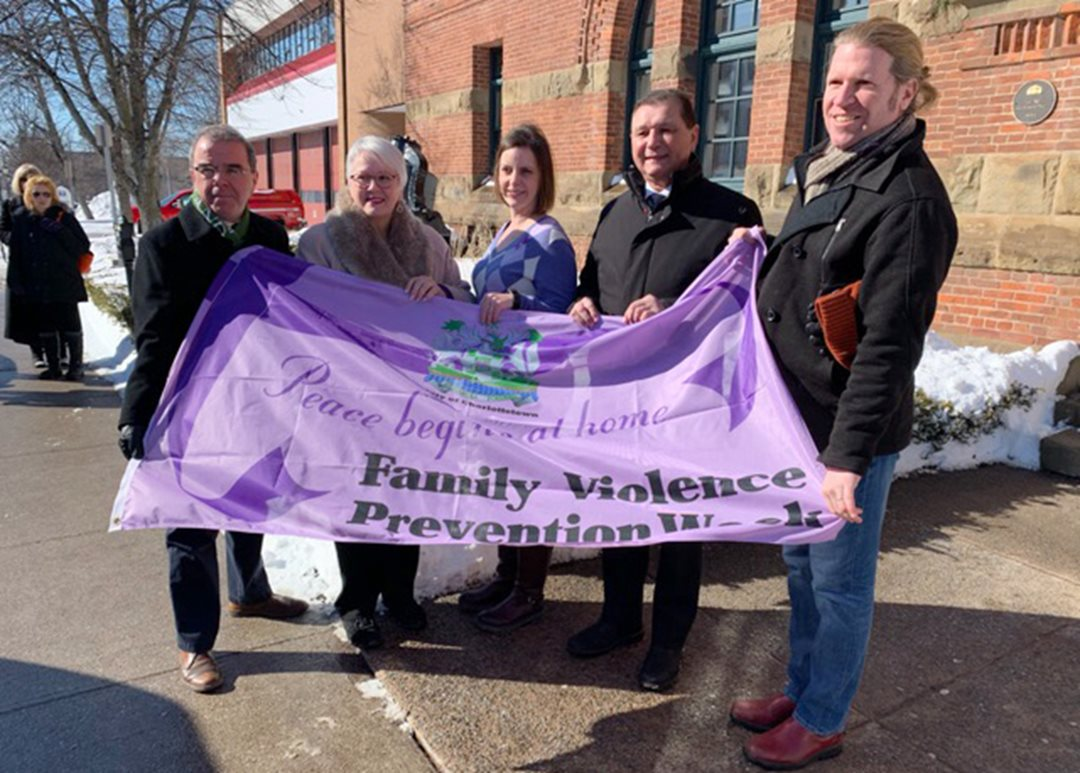 "Thursday, February 14 – Senator Brian Francis participates in an activity held at City Hall in Charlottetown to mark Family Violence Prevention Week in Prince Edward Island. This year's theme is ""Engaging Men and Boys in Family Violence Prevention."""