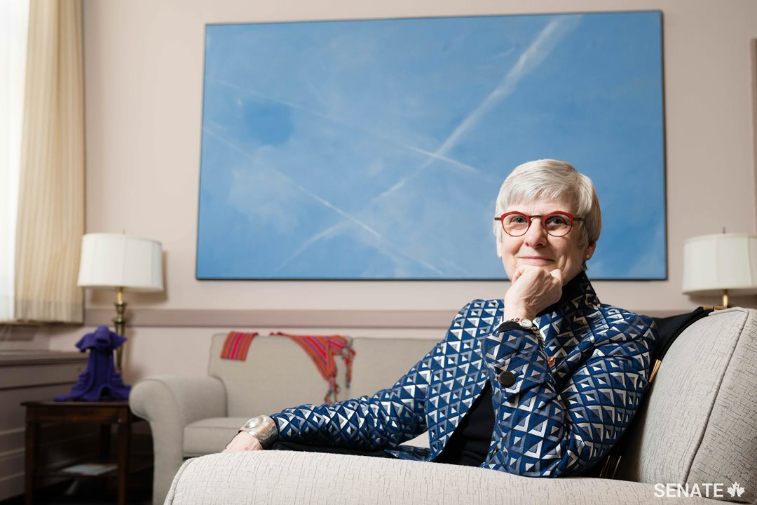 "Senator Patricia Bovey's East Block office features a work by Manitoba painter Roger Lafrenière, ""The Zone,"" a 1.5 x 3-metre canvas depicting a vast contrail-streaked Prairie sky."