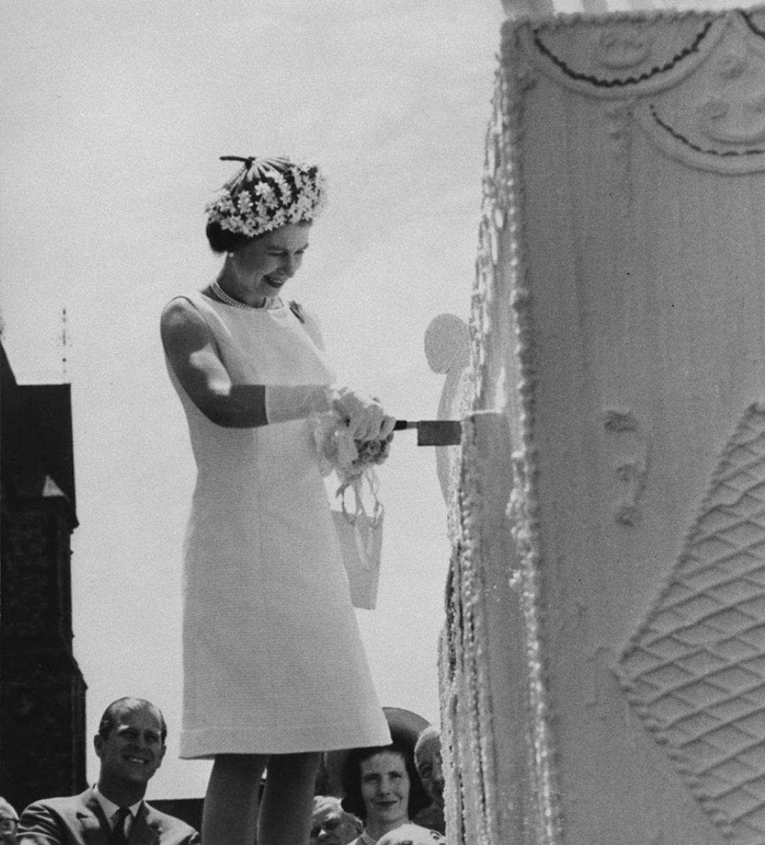 Queen Elizabeth II cuts a giant four-storey birthday cake during centennial celebrations on Parliament Hill on July 1, 1967. (Library and Archives Canada)
