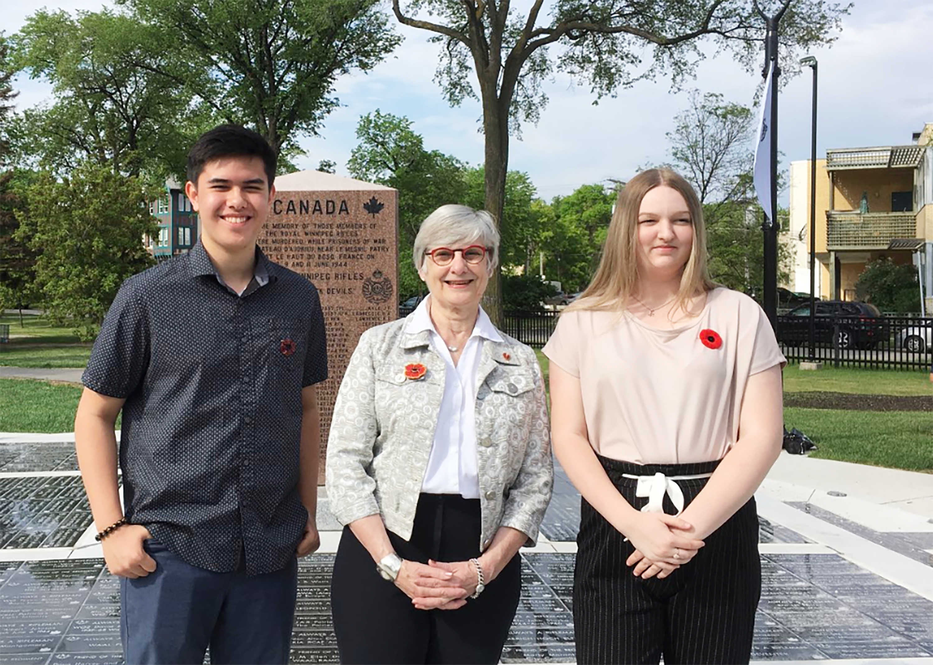 Saturday, June 8, 2019 — Senator Patricia Bovey congratulates Winnipeg students Jordan Talledo and Alyssa Mason who were selected to join 24 students to tour Canadian battlefields of the first and second world wars as part of the Juno75 Student Pilgrimage in July. This once-in-a-lifetime opportunity for high school students from across Canada is sponsored by the Juno Beach Centre and will enable participants to travel to Northern France and Belgium to gain first-hand knowledge of Canada's participation in the first and second world wars.
