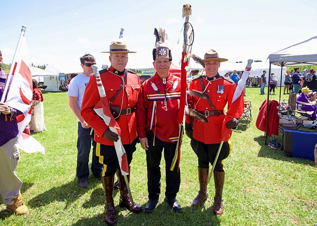 Sunday, June 9 and Monday, June 10, 2019 — Senator Brian Francis meets members of the Royal Canadian Mounted Police as he attends the Abegweit First Nation's 20th Annual Mawiomi (powwow) in Scotchfort, Prince Edward Island.