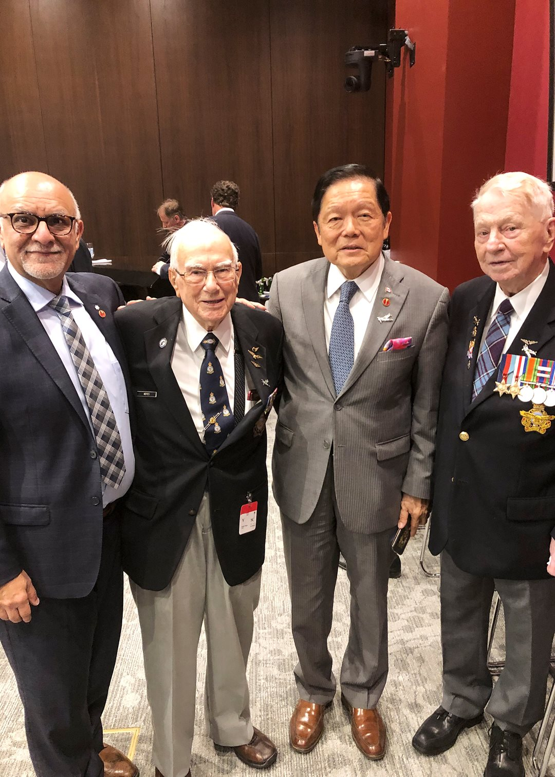 Tuesday, June 4, 2019 — Senators Mohamed-Iqbal Ravalia (far left) and Victor Oh (second from the right) meet veterans Robert Bradley (second from the left) and Ronald Moyes (far right) during the 13th annual Air Force Day on Parliament Hill. The day is an opportunity for parliamentarians to honour the courage, bravery and service of members of the Royal Canadian Air Force (RCAF).