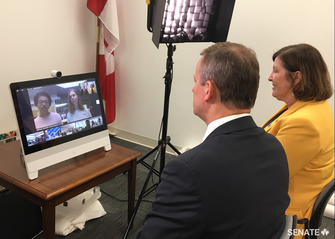 Thursday, May 16, 2019 — Senators David M. Wells and Mary Coyle speak to students across the country via live videoconference organized by SENgage and the Centre for Global Education. This initiative brought together students aged 12 to 15, in six classrooms, from British Columbia, Alberta, Ontario and New Brunswick for an hour of frank discussion about how the Senate works, recent legislation and how senators represent Canadians in Parliament.